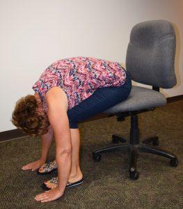Lori Kelly forward fold sitting