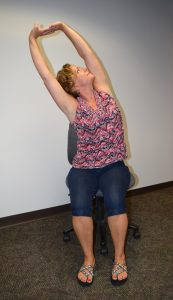 Lori Kelly side bend sitting